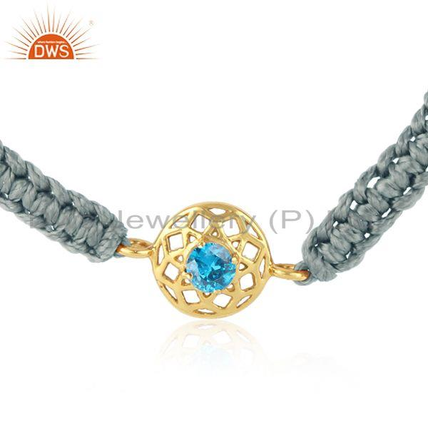 Floral designer gray cord gold on silver bracelet in blue cz