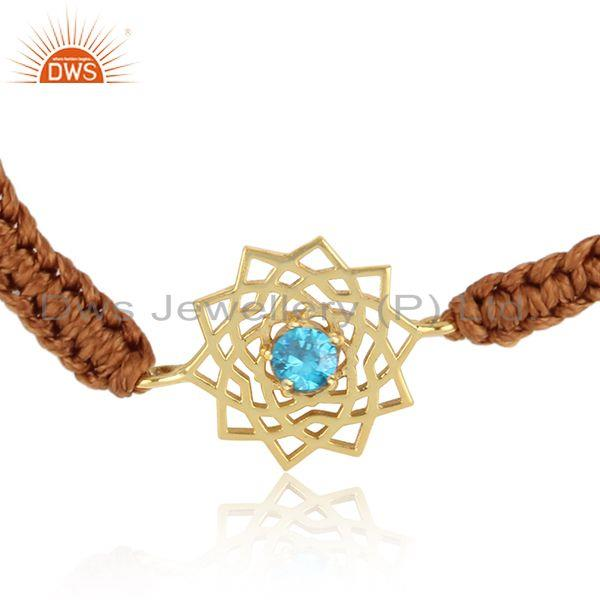 Designer chakra gold on silver brown cord bracelet with blue cz