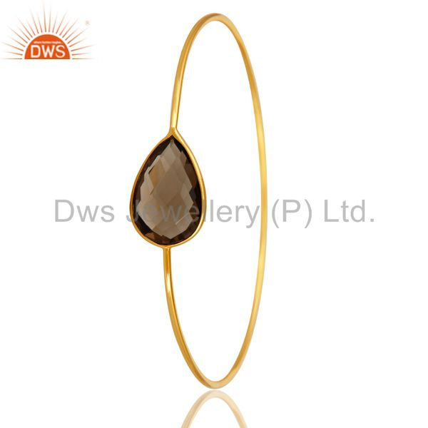 Supplier of 14k gold plated sterling silver faceted smokey quartz sleek bangle
