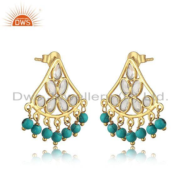 Traditional designer earring in gold on silver with turquoise, cz