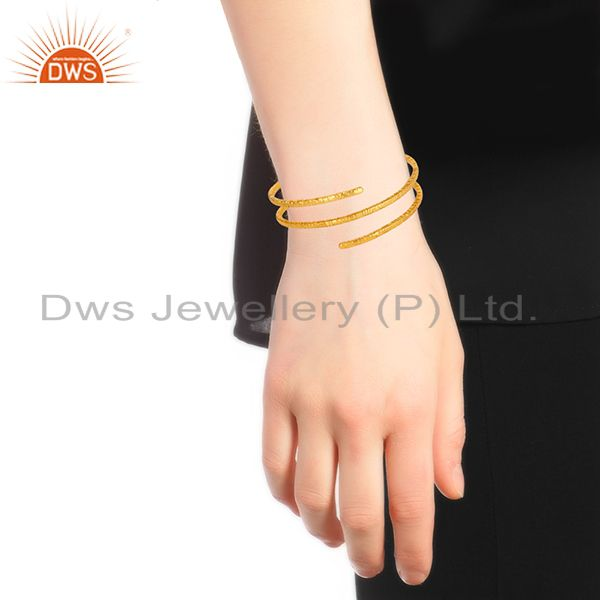 Wholesalers of 18-carat yellow gold plated brass wire bangle bracelet jewelry