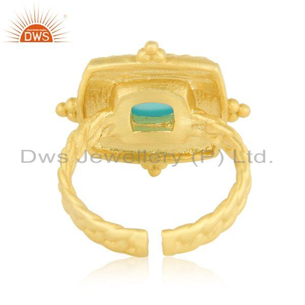 Designer of Bold hammered fashion ring with gold on and aqua chalcedony
