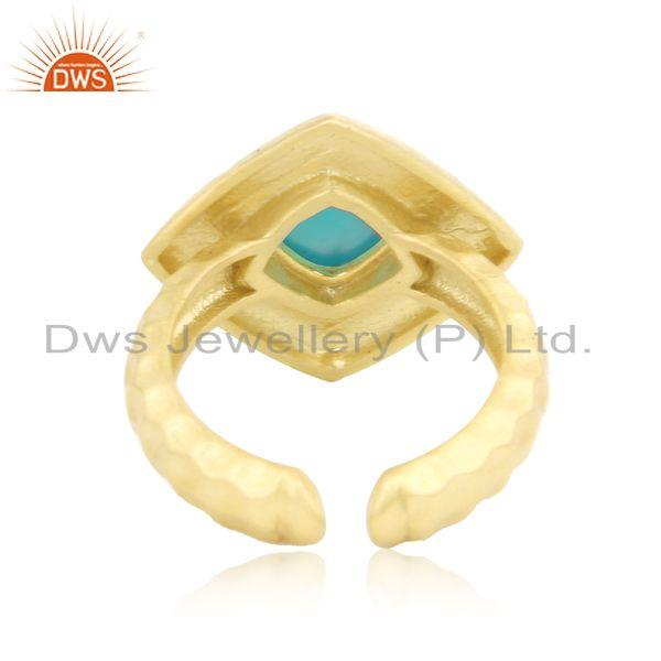 Designer of Hammered handcrafted fashion ring with gold on and aqua chalcedony