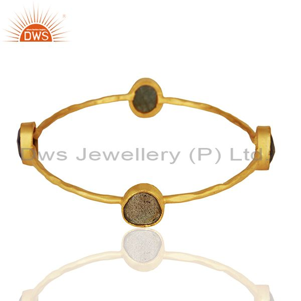 Wholesalers of Simple design gold on brass fashion gemstone bangle manufacturers