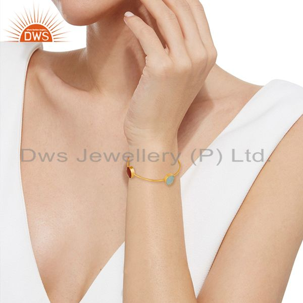 Wholesalers of Handmade bezel set multi gemstone gold plated brass bangle wholesale