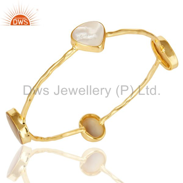 Wholesalers of 14k yellow gold over sterling silver mother of pearl sleek bangle