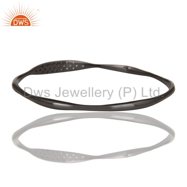 Manufacturer of 18k gold over black oxidized 925 silver white topaz bangle jewelry