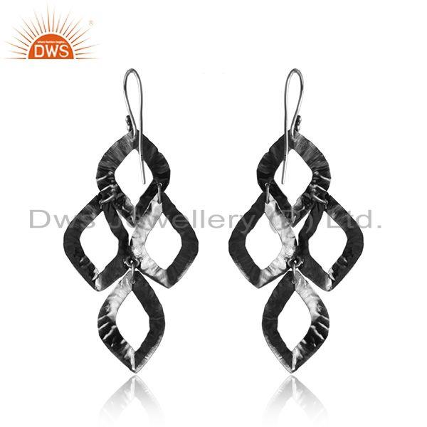 Designer of Designer textured dangle earring in oxidized silver 925