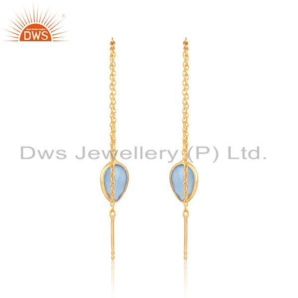 Designer of Designer chain dangle in yellow gold on silver blue chalcedony
