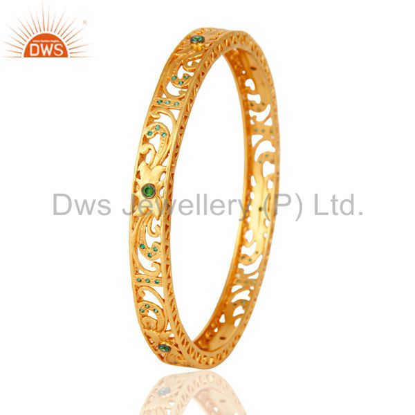 Wholesalers of 14k yellow gold plated filigree bangle with green cubic zirconia
