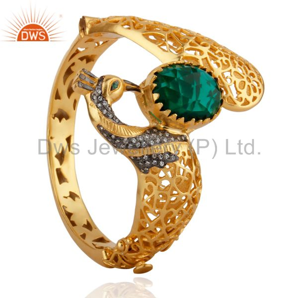 Wholesalers of 18k gold on unique peacock design openable bangle green glass cz