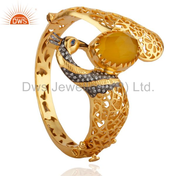 Wholesalers of 14k gold on yellow moonstone womens fashion peacock bangle with cz