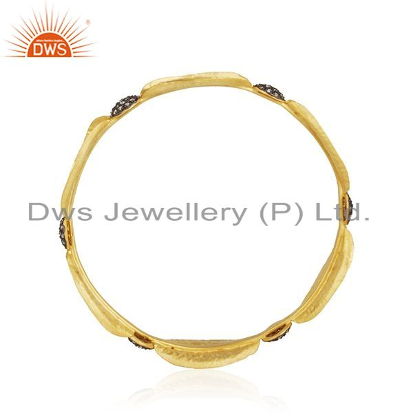Wholesalers of 14k yellow gold plated 925 silver cubic zirconia fashion bangle