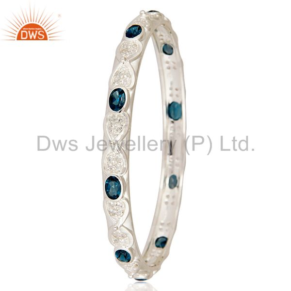 Manufacturer of London blue topaz gemstone sterling silver bangle with white topaz