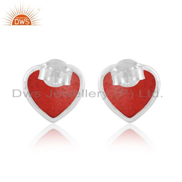 Designer of Dainty stud in white rhodium on silver 925 with light red enamel