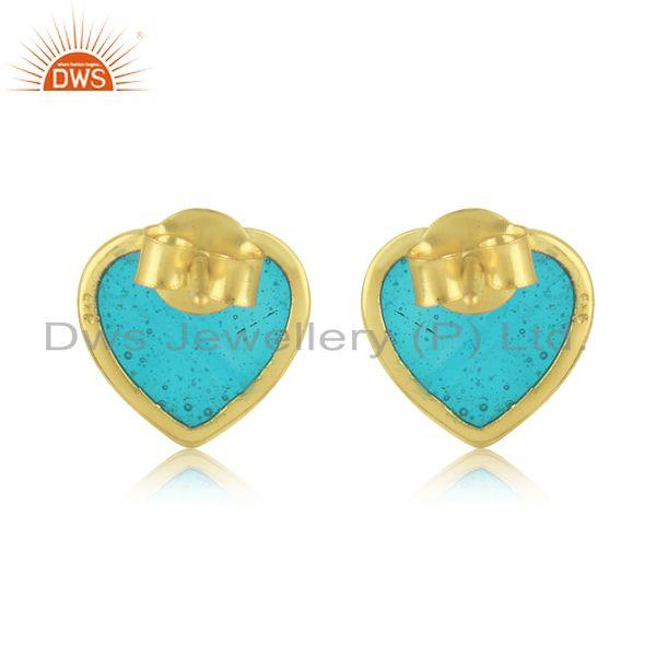 Designer of Dainty stud in yellow gold on silver 925 with light blue enamel