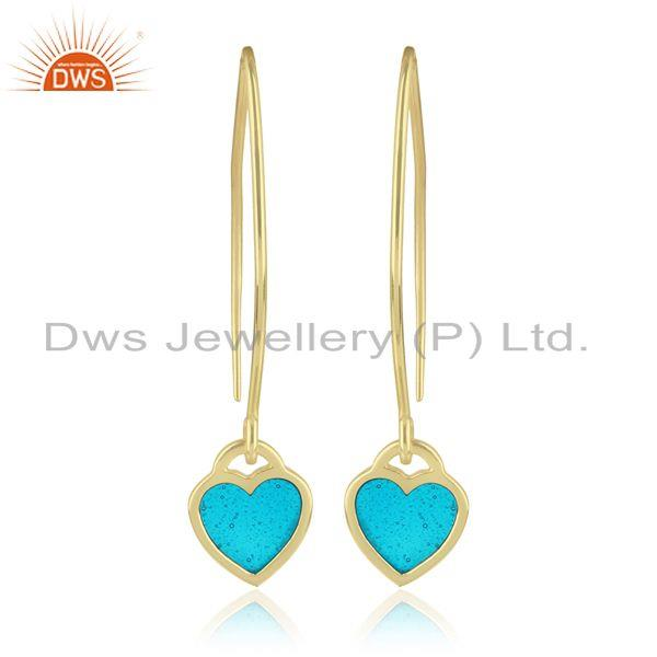 Designer of Dangle earring in yellow gold plated silver with light blue enamel