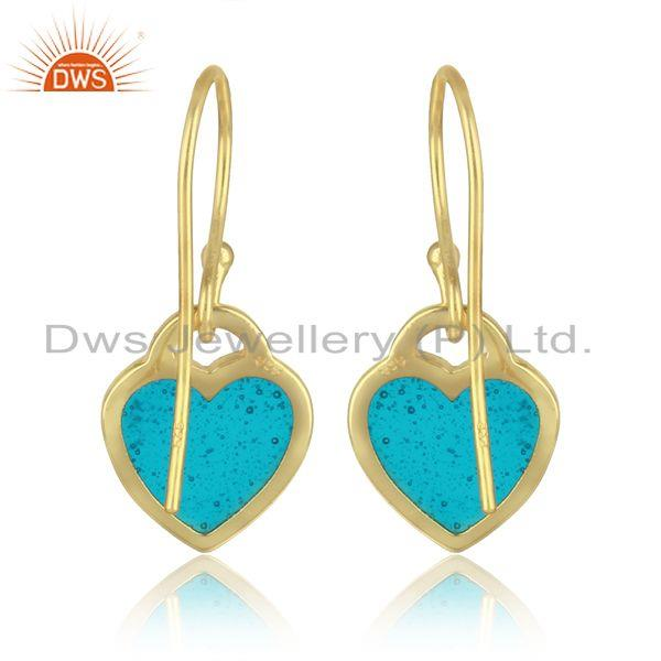 Designer of Heart dangle in yellow gold plated silver with light blue enamel