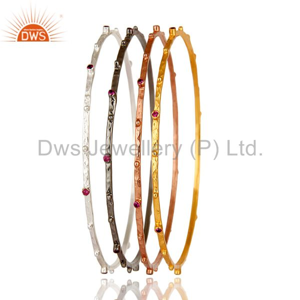 Wholesalers of 14k yellow gold brass ruby red cubic zirconia bangles set 4 pieces