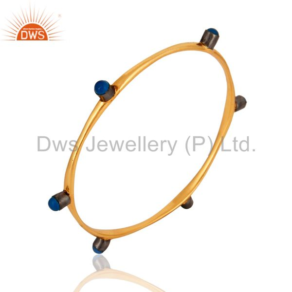 Wholesalers of 18-carat yellow gold plated blue chalcedony gemstone womens bangle