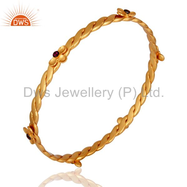 Wholesalers of 18k yellow gold plated red cubic zirconia handmade bangle