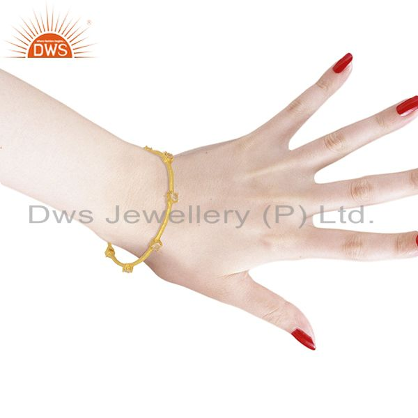 Wholesalers of Rose quartz sleek 14k yellow gold plated 925 sterling silver bangle