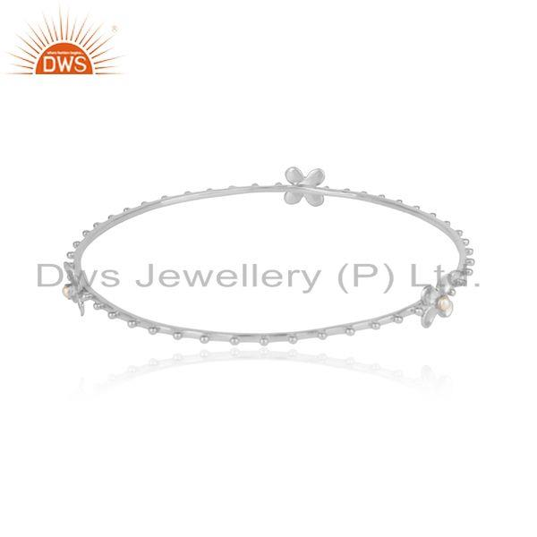 Designer of Designer floral bangle made of solid silver with white pearl