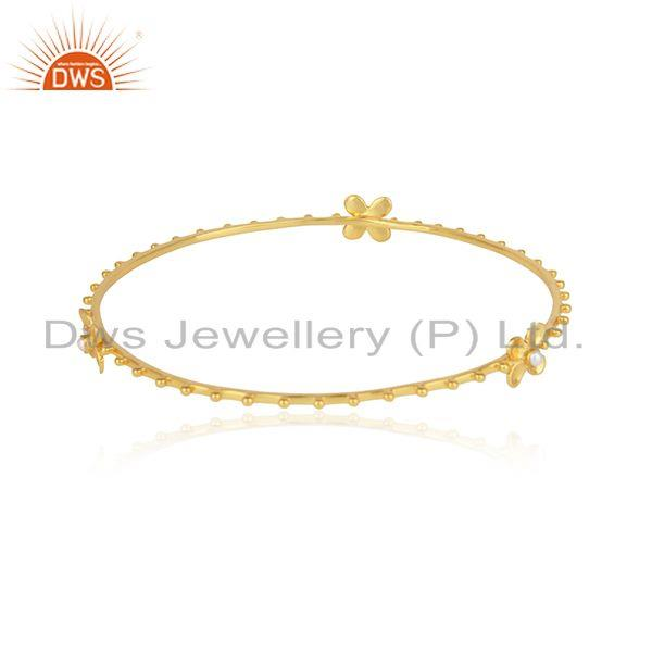 Designer of Designer floral silver bangle with 18k yellow gold on and pearl