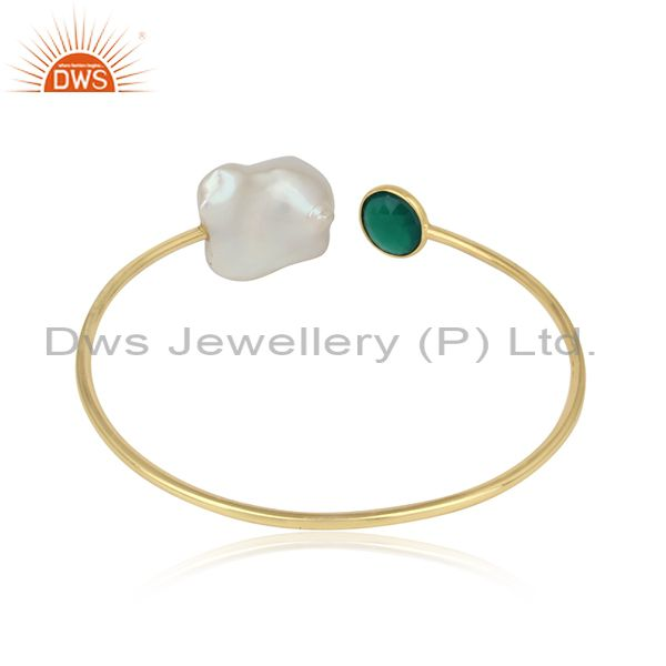 Designer of Handcrafted gold on silver cuff with green onyx and natural pearl