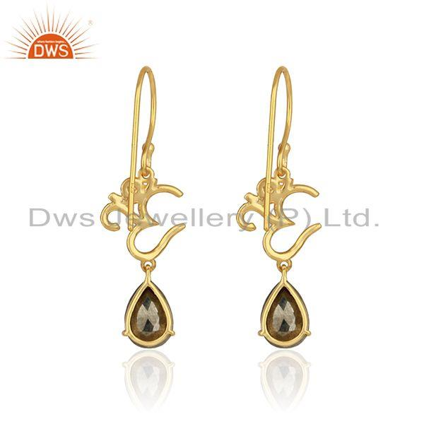 Designer of Om symbol earrings in yellow gold on 925 silver with shiny pyrite