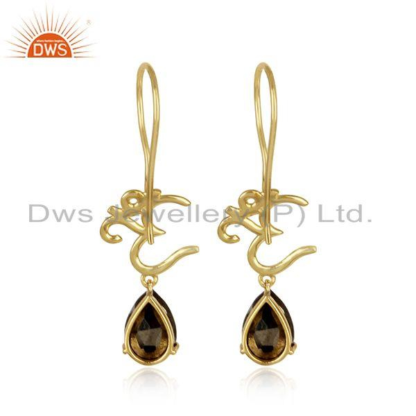 Designer of Spiritual om earrings in yellow gold on 925 silver with pyrite