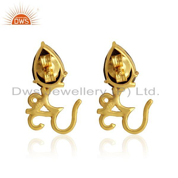 Designer of Om symbol stud in yellow gold on 925 silver with shiny pyrite