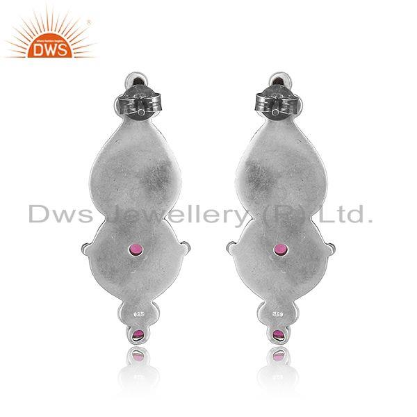 Designer of Handcrafted floral design tribe red stone earring in oxidized silver