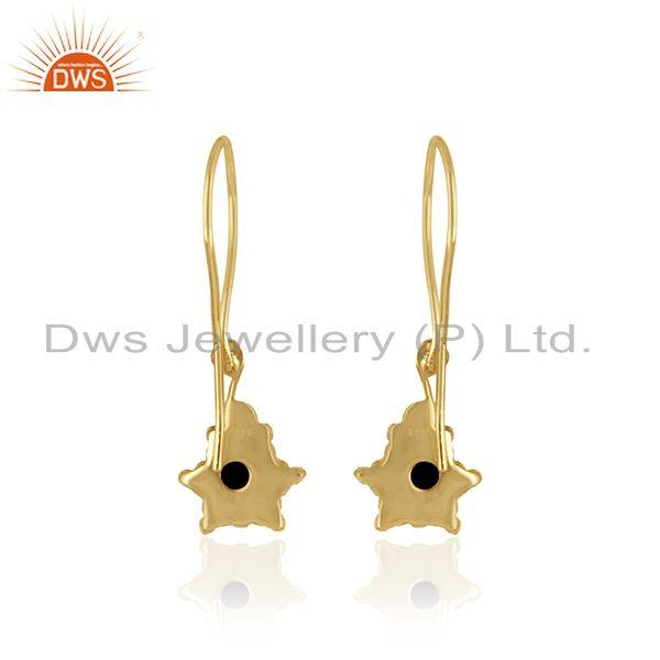 Designer of Designer dangle earring in yellow gold on silver with black onyx
