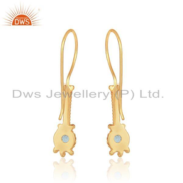 Designer of Designer long earring in yellow gold on silver with blue topaz