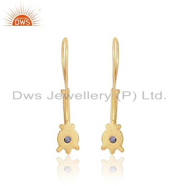 Designer of Elongated designer earring in yellow gold on silver with iolite