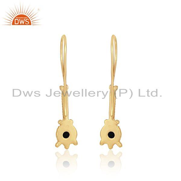 Designer of Designer long earring in yellow gold on silver with black onyx