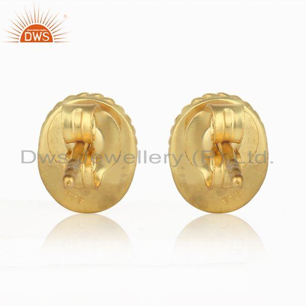 Designer of Textured silver stud with blue corundum and yellow gold plating
