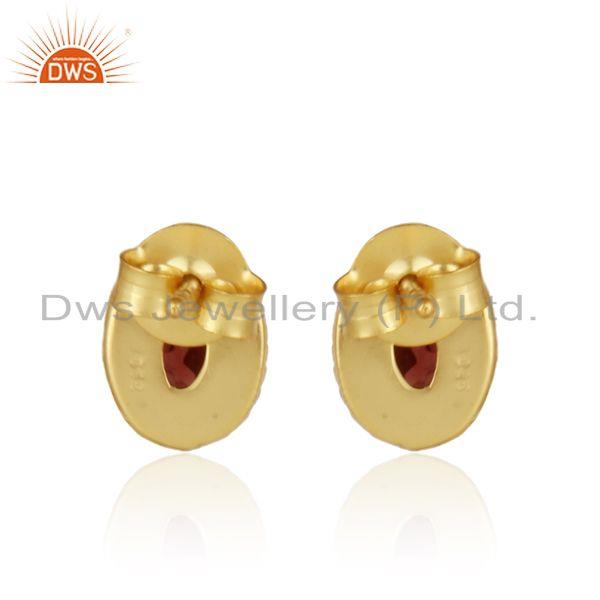 Designer of Textured silver 925 stud with garnet and yellow gold plating