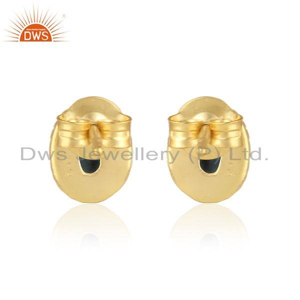 Designer of Textured silver stud with blue sapphire and yellow gold plating