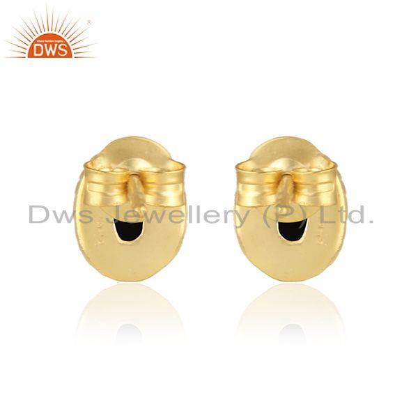 Designer of Textured silver 925 stud with blck onyx and yellow gold plating
