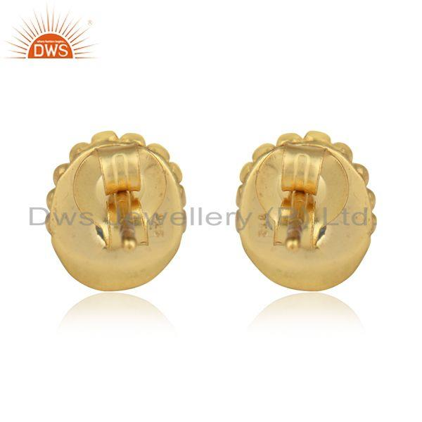 Designer of Designer handmade stud in yellow gold on silver with blue topaz