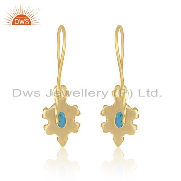 Designer of Textured earring in yellow gold on silver with london blue topaz