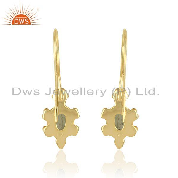 Designer of Handcrafted dangle earring in yellow gold on silver with peridot