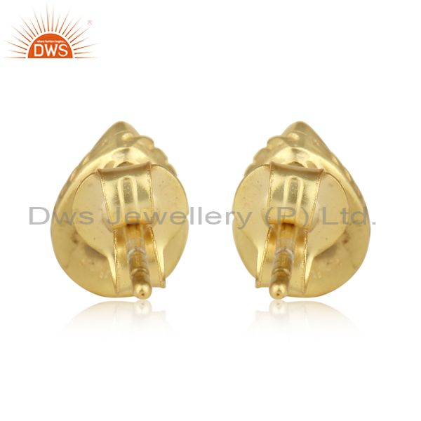 Designer of Textured stud in yellow gold on silver 925 with blue topaz