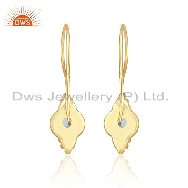 Designer of Textured earring in yellow gold on silver 925 with blue topaz