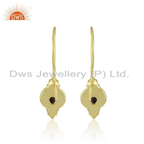 Designer of Textured dainty earring in yellow gold on silver 925 with garnet