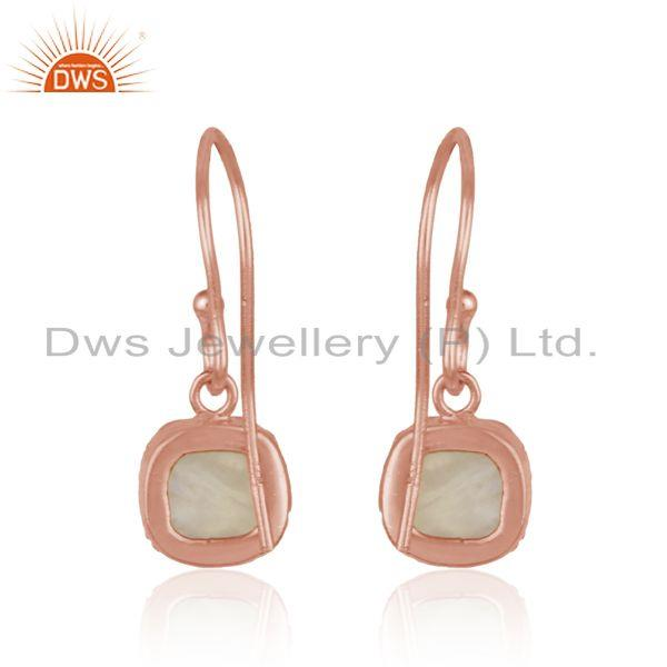 Designer of Handmade dangle in rose gold on silver with rainbow moonstone
