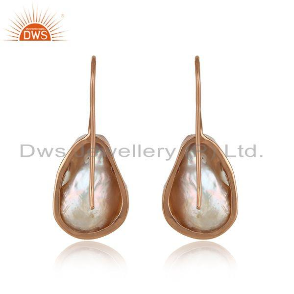 Designer of Handmade earring in rose gold on silver with organic shape pearl
