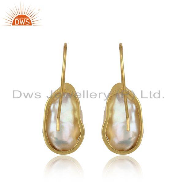 Designer of Handmade earring in yellow gold on silver with organic shape pearl